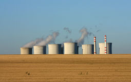 Cooling towers over agriculture field Stock Image