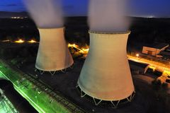 Cooling towers of a power plant. A night shot stock photos