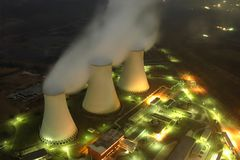 Cooling towers of a power plant. A power plant - night view down stock image