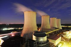 Cooling towers of a power plant. A night shot royalty free stock image
