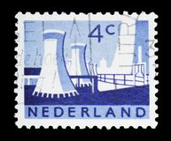 Cooling towers of the public coal mines in Limburg province, Landscapes serie, circa 1963. MOSCOW, RUSSIA - FEBRUARY 10, 2019: A stamp printed in Netherlands stock photo