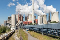 Cooling towers and smokestacks coal fired power plant in Germany royalty free stock photo