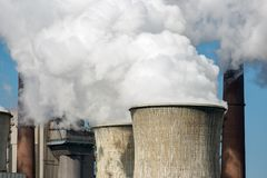 Cooling towers and smokestacks coal fired power plant in Germany stock images