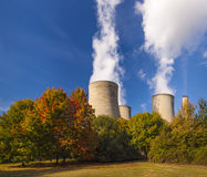 Cooling towers spew clouds into the atmosphere Royalty Free Stock Photography