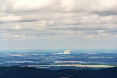 Cooling towers with steam vapour at nuclear power station. Cooling towers with steam vapour from Temelin nuclear power station in Czech Republic on cloudy day Royalty Free Stock Photos
