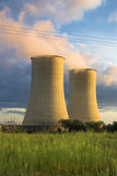 Cooling Towers at Sunset. Cooling Towers at a power plant bathed by the late sun Royalty Free Stock Image