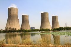 4 Cooling towers of Thermal Power Plant. Natual draft Cooling towers of Thermal Power Plant at UP, India. Their reflection in adjacent pond Royalty Free Stock Photos
