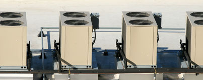 Cooling Units. A row of high rise cooling units Stock Photography
