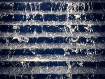 Cooling Water Flowing Down Black Stair Steps. For Landscape Decoration Stock Images