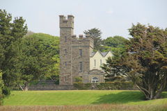 Coolmain Castle County Cork Ireland. With trees and a lawn in the foreground Stock Photo