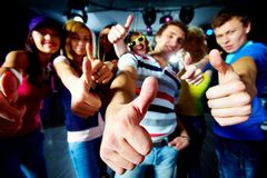 Coolness. Photo of friends showing thumbs up meaning cool party Stock Photos