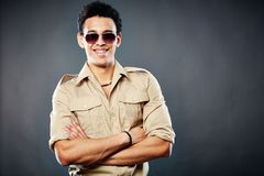 Coolness. Copy-spaced shot of a happy dude posing against black background Stock Images