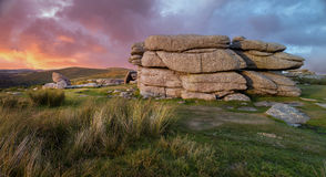 Coombestone Tor on Dartmoor in Devon. Sunset over Dartmoor National Park in Devon stock photo