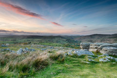 Coombestone Tor. Sunset over Dartmoor from granite rock formations at Coombestone Tor near Yelverton royalty free stock image