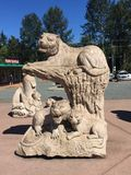 Stone sculpture of lion and cubs, Coombs, BC stock photos