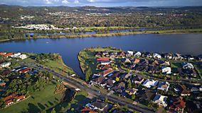 On The lake Regatta Waters Parkland Gold Coast Grass play area House Estate next to Coomera River Hope Island, Stock Photo