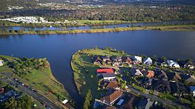 Morning view Regatta Waters On The lake and Parkland Gold Coast Grass play area House Estate next to Coomera River On The lake, Stock Image
