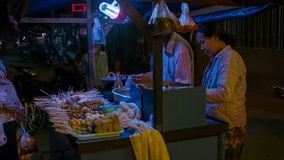 Coomon Asian street snack food seller with mobile counter for cooking stock video