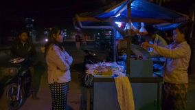 Coomon Asian street snack food seller with mobile counter for cooking at evening stock footage