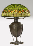 Cooper base table lamp with stained glass shade Stock Photos