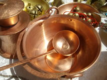Cooper ladle. Into a copper vessel and other handmade items Stock Image