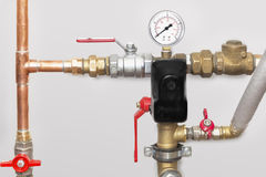 Cooper pipes with ball valves and manometer Royalty Free Stock Photography