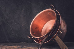 Cooper pots and pans on the stone table horizontal Stock Photography