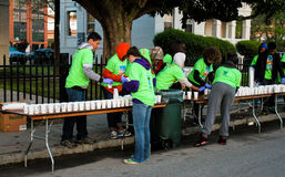 2015 Cooper River Bridge, Charleston, SC. Volunteers get cups of water ready as competitors in the Cooper River Bridge Run will be arriving soon stock images