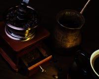 Cooper turkish pot, vintage coffee grinder stock images
