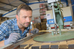 Cooper watching machine press planks wood together Royalty Free Stock Image