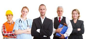 Cooperação dos trabalhos de equipa com as ocupações diferentes Fotografia de Stock