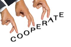 Cooperate. Hands as finger walking on Cooperate word stock image