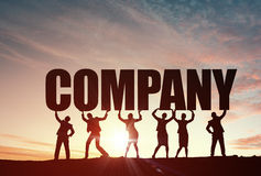 Cooperate for successful work. Business people lifting word company representing collaboration concept royalty free stock image