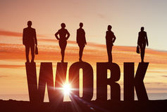 Cooperate for successful work. Business people standing on word work representing collaboration concept royalty free stock images