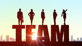 Cooperate for successful work. Business people standing on word team representing collaboration concept stock photo