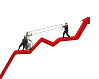 Cooperating to move up money symbol on red arrow Stock Photos