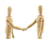 Cooperation. Wooden dummies shaking hands, Cooperation of business Stock Photography