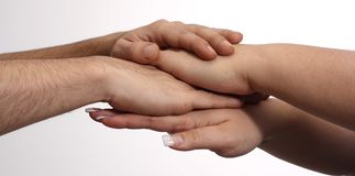 Cooperation. Between man and woman, two human hands Royalty Free Stock Photography