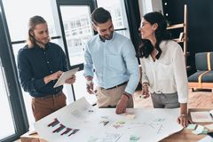 Cooperation in action. Group of young confident business people royalty free stock image