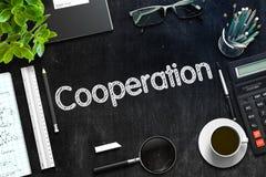 Cooperation on Black Chalkboard. 3D Rendering. Black Chalkboard with Cooperation Concept. 3d Rendering. Toned Illustration Stock Photo