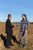Cooperation between a businessman and a farmer Stock Photo
