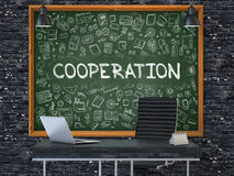 Cooperation on Chalkboard with Doodle Icons. 3D Illustration. Cooperation Concept Handwritten on Green Chalkboard with Doodle Icons. Office Interior with Modern Royalty Free Stock Images