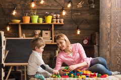 Cooperation concept. Mother and son cooperate in building structure model, cooperation. Cooperation and cooperative. Learning. Cooperation in education stock image