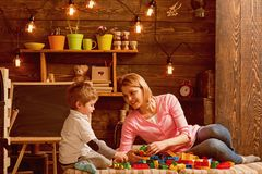 Cooperation concept. Mother and son cooperate in building structure model, cooperation. Cooperation and cooperative. Learning. Cooperation in education royalty free stock images
