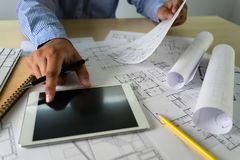 Cooperation Corporate computer laptop and pro digital  architectural project Architects working work royalty free stock photos