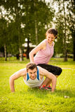 Cooperation - couple training together Stock Photo