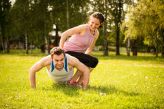 Cooperation - couple training together Stock Photography