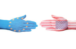 Cooperation between the EU and the U.S. Two hand colored in the form of flags Stock Image