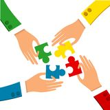 Cooperation Of Four Business Man Holding Puzzle Peaces. In their Hands with colorful Suits Stock Image