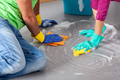 Cooperation in housework Stock Photos
